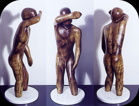 Trying to Hide - walnut figurative sculpture by Christopher Rebele