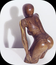 Watching and Waiting - walnut figurative sculpture by Christopher Rebele